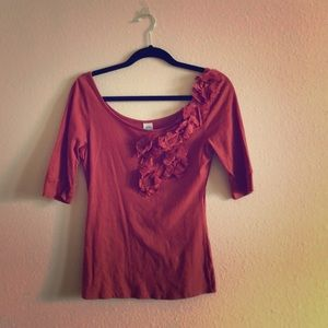 Burnt orange Anthro top with floral neckline